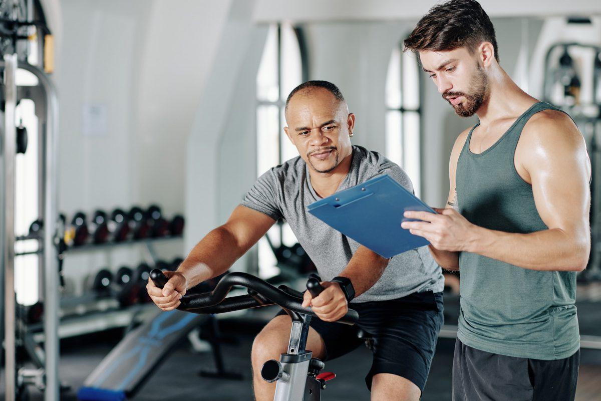 Trainer writing workout program
