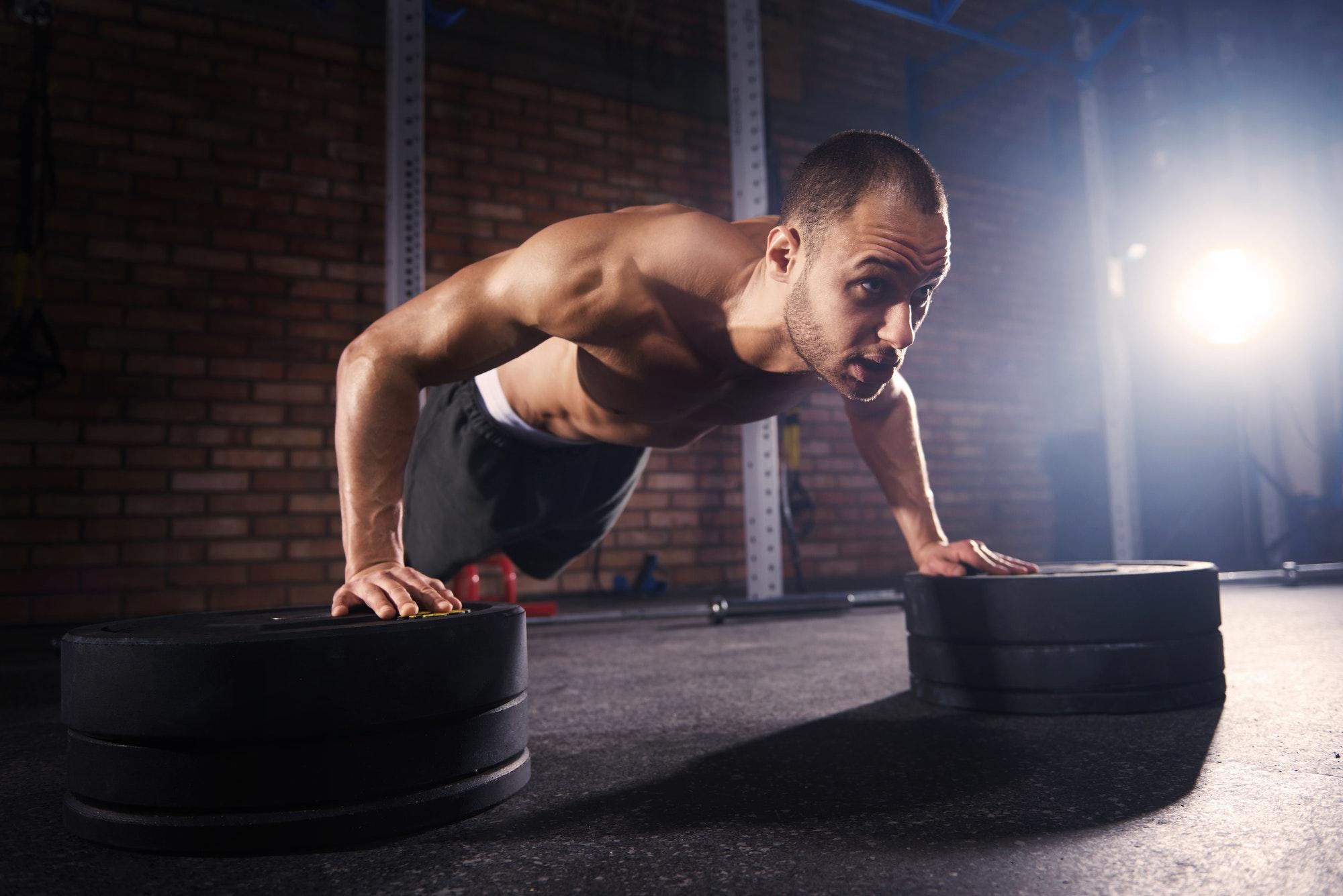 Muscular man working on body strength